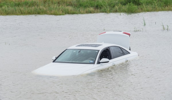 Car Filling Up with Water in River