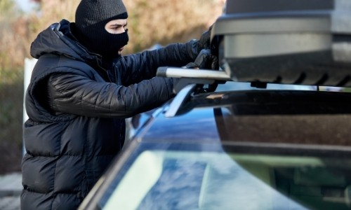 Thief Stealing from Roof Box